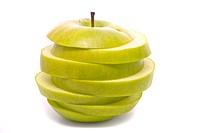 Sliced green apple on studio white