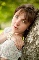 A young slim attractive girl in her late teens or early 20´s, outdoors in a woodland glade  UK