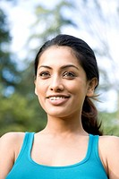 Smiling Indian woman outdoors