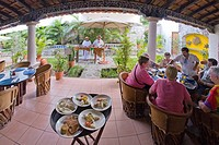Plates of food on stand in restaurant in San Miguel, Cozumel, Mexico