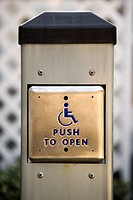 Metal door entrance button for physically challenged or handicapped people.