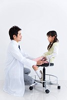 Doctor examining a child