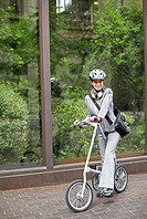 Businesswoman Commuting with Bicycle