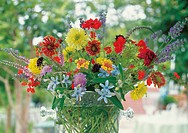 Freshly picked flowers on a table outside