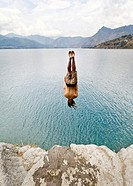 Guatemala, San Marcos La Laguna, man jumping off cliff