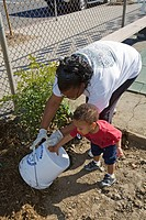 An African_American Mother and son at Tree Planting at Calvert Elementary School in Woodland Hills. .
