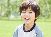 Boy Portrait Looking At Camera Smiling Mouth Open