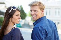 Close_up of a young couple smiling