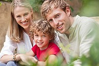 Portrait of a cheerful couple with son
