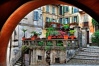 Looking through an arch in old houses in the town of Orta in Piedmont, Italy