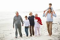 Multi_generation family walking on the beach