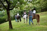 little girls is riding a horse