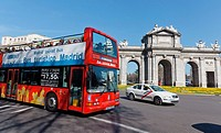 Double deck bus in front of Puerta de Alcala, Madrid, Spain