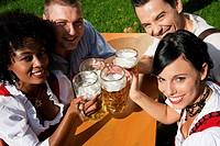 Group of four friends in beer garden