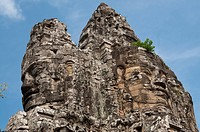 Top of major gate tower with large sculptures of heads, at Khmer temple, Angkor Thom, Siem Riep, Cambodia
