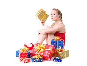 beautiful girl in red dress with christmas presents