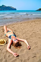 sexy woman is lying on the beach and, top view