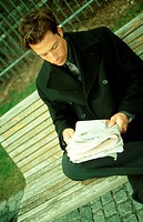 Reading Man on Park Bench