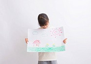 Girl holding drawing