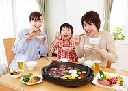 Parents and kids eating Japanese barbeque