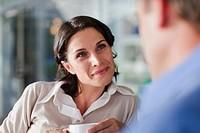 Woman talking to man at cafe
