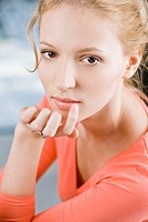 Woman applying ointment for cold sores