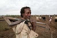 Ethiopian shepherd protects his herd with a gun