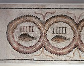 Roman civilization, 3rd century A.D. Mosaic depicting medallions enclosing a fish and five vertical bars, symbolf of a group of fighters in the arena....