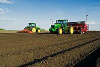 Prepping field and planting potatoes, near Cypress River, Manitoba, Canada