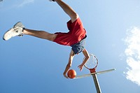 Teenager jumping with basketball