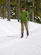 A cross country skiier enjoys the groomed trails at Dakota ridge, near Gibsons, British Columbia, Vancouver coast and mountain region, Canada