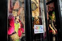 Discount sales on a shop selling bizarre costums, Rue Quincampoix, Le Marais area, Paris, France