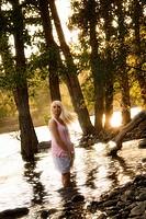Young blonde woman outdoors in Spokane, Washington, USA.