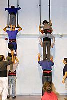 Castellers de la Vila de Gracia training ´Castellers´ building human tower, a Catalan tradition Headquarters of Castellers de la Vila de Gracia Barcel...