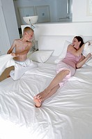 Boy having pillow fight with his mother