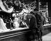 Three boys mesmerized by Xmas toys in shop window in New York City. Ca. 1915. BSLOC_2010_18_108