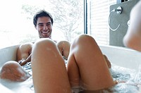 Couple taking a bubble bath