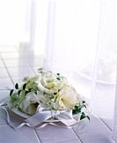 Bouquet of white flowers on white tiles