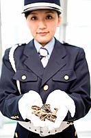 Female guard holding keys
