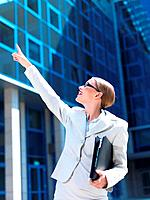 Beautiful business woman standing outdoor modern building