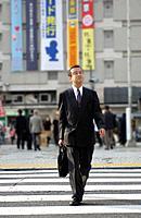 Businessman crossing street, Tokyo prefecture, Japan
