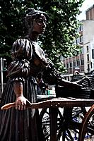 Detail destaurated view of bronze statue of Molly Malone, Grafton Street, Dublin, Southern Ireland