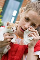 Girl suffering from cat allergy