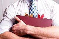 Leaves in businessman's folder
