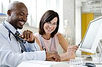 Business man and business woman working in office, smiling