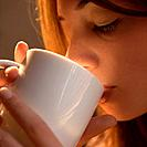 Woman drinking from cup