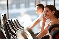 Woman using cell phone on treadmill