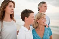 Caucasian family enjoying beach