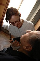 Photo essay. Independent nurse, in Bordeaux, France. The nurse is coming to the home of a couple of elderly people aged respectively 97 years old for ...