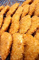 Croquettes on tray, close up